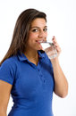 Healthy young woman drinking a glass of water Royalty Free Stock Photo
