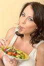 Healthy Young Woman Enjoying Eating a Fresh Mixed Salad Royalty Free Stock Photo
