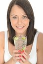 Healthy young woman holding a glass of still water with ice and lime dslr royalty free image happy attractive cubes fresh ripe Royalty Free Stock Photo