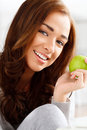 Healthy young woman holding green apple Royalty Free Stock Photo