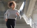 Healthy young woman running outdoors Royalty Free Stock Photo