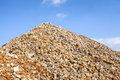 Heap of brick rubble red contrasted to blue sky Stock Photo
