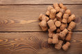 Heap of champagne corks over rustic wooden table background Royalty Free Stock Photo