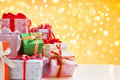 Heap of Christmas gift over blur light Royalty Free Stock Photo