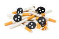 Heap of cigarettes with black skulls isolated on white background Royalty Free Stock Photo
