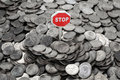 Heap of coins and sign Stop Stock Images