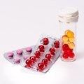Heap of colorful pills medical background isolated Royalty Free Stock Photos