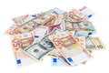 Heap of dollar and euro banknotes isolated on white background with clipping path Stock Photos