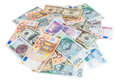 Heap of dollar euro and polish zloty banknotes isolated on white background with clipping path Royalty Free Stock Images