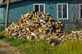 Heap of firewoods wirewoods in front a rural house Royalty Free Stock Photography