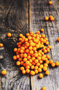 Heap of fresh buckthorn on rustic wooden background