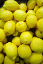 Heap of fresh lemons in supermarket nature background Stock Photos