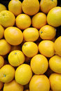 Heap of fresh orange in supermarket nature background Stock Image