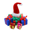 Heap of gifts with santas hat isolated colorful gift boxes and red on top Stock Photography