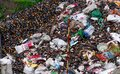 Heap of glass bottle of beverage. Rubbish waiting for recycle in recycling business. Recycle industry. A pile of energy drink bott