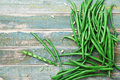 Heap of green or string beans on rustic table top view. Organic and diet food. Farmers autumn harvest. Royalty Free Stock Photo