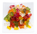Heap of gummi bears on a plate isolated white background Stock Images