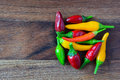 Heap of hot red, green and yellow chili peppers Royalty Free Stock Photo