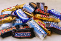 Heap of Mars, Snickers, Milky Way, Bounty and Twix chocolate can Royalty Free Stock Photo