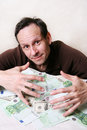 Heap of money the adult the man with a Royalty Free Stock Photography