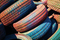 Heap of old colorful worn out car tires automotive Royalty Free Stock Photos