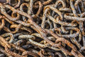 Heap of old rusty chain links very obsolete weathered badly corroded covered with layers decomposed metal crust and scales Stock Image