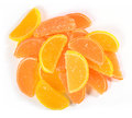 Heap of orange and lemon candy slices on a white Royalty Free Stock Photo
