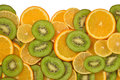 Heap of orange, lemon and kiwi slices on a white Royalty Free Stock Photo