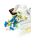 Heap of pills and syringes Royalty Free Stock Photo
