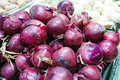 Heap of red onion in supermarket nature background Royalty Free Stock Photos