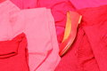 Heap of red and pink clothes with womanly shoes shirts pants Stock Photo