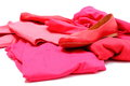 Heap of red and pink clothes with womanly shoes shirts pants isolated on white background Stock Image