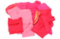 Heap of red and pink clothes with womanly shoes shirts pants isolated on white background Royalty Free Stock Photography