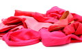 Heap of red and pink clothes with womanly shoes shirts pants isolated on white background Stock Photos