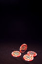 Heap of red poker chips on black background Royalty Free Stock Photo