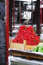 Heap of red radish on market in wooden container in outdoor at winter Royalty Free Stock Images