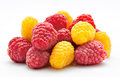 Heap of red and yellow raspberry on white Royalty Free Stock Photo