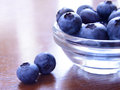Heap of ripe blueberries in the glass bowl Stock Photos