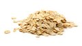 Heap of rolled oats on white Stock Photo