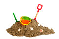 Heap sand with plastic toys at the beach Royalty Free Stock Photos