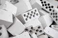 Heap of silicate bricks many white with openings lie in one Stock Images