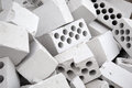 Heap of silicate bricks many white with openings lie in one Royalty Free Stock Photos