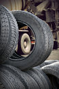 Heap of tires with big truck in background Royalty Free Stock Photos