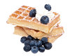 Heap of waffles with fruits and cream Royalty Free Stock Photo