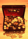 Heaped of gold coins on a wooden table Stock Image