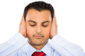 Hear no evil closeup portrait of handsome man covering his ears isolated on white background concept Stock Photos