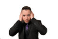 Hear no evil a young man covering his ears in the pose Stock Photo