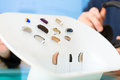 Hearing aid on a presentation table closeup of selection of aids Stock Photo