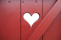 Heart ancient red wooden door with cut out Royalty Free Stock Images