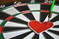 Heart and arrow on dart board Royalty Free Stock Photo